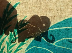 Elephant shadow puppet behind the screen