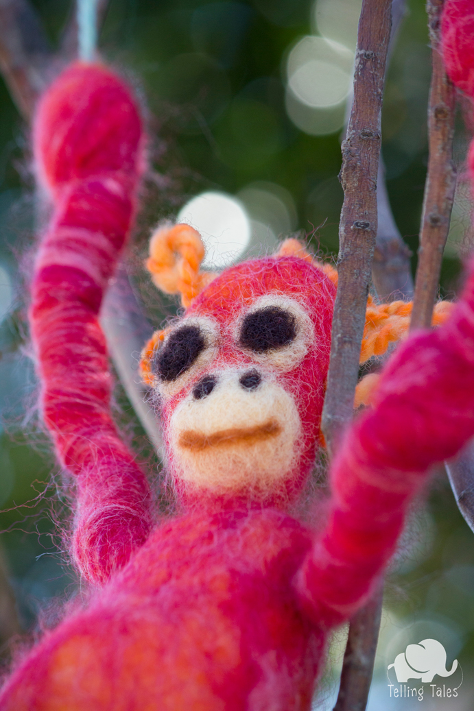 Chilli, the orangutan felted marionette looking out at the trees