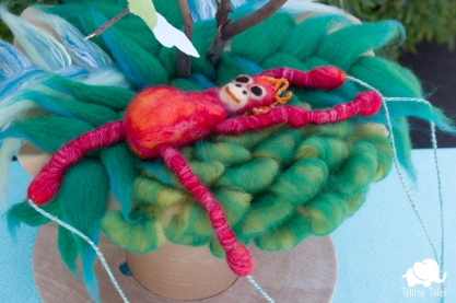 Chilli, the orangutan felted marionette relaxing in the shade