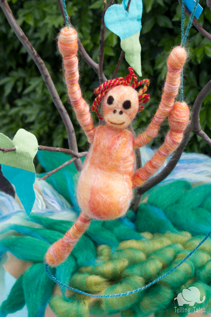 Lily, the orangutan felted marionette swinging from a vine